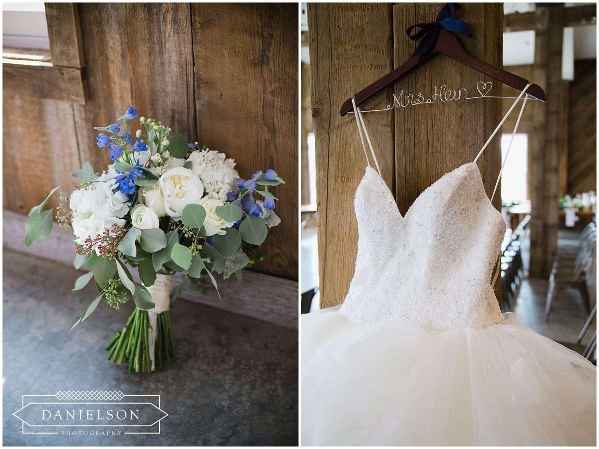 Rapid Creek Cidery weddings, Iowa CIty wedding photographer, Cedar Rapids wedding photographer, Rapid Creek Cidery, delphinium wedding bouquet, wedding dress shots