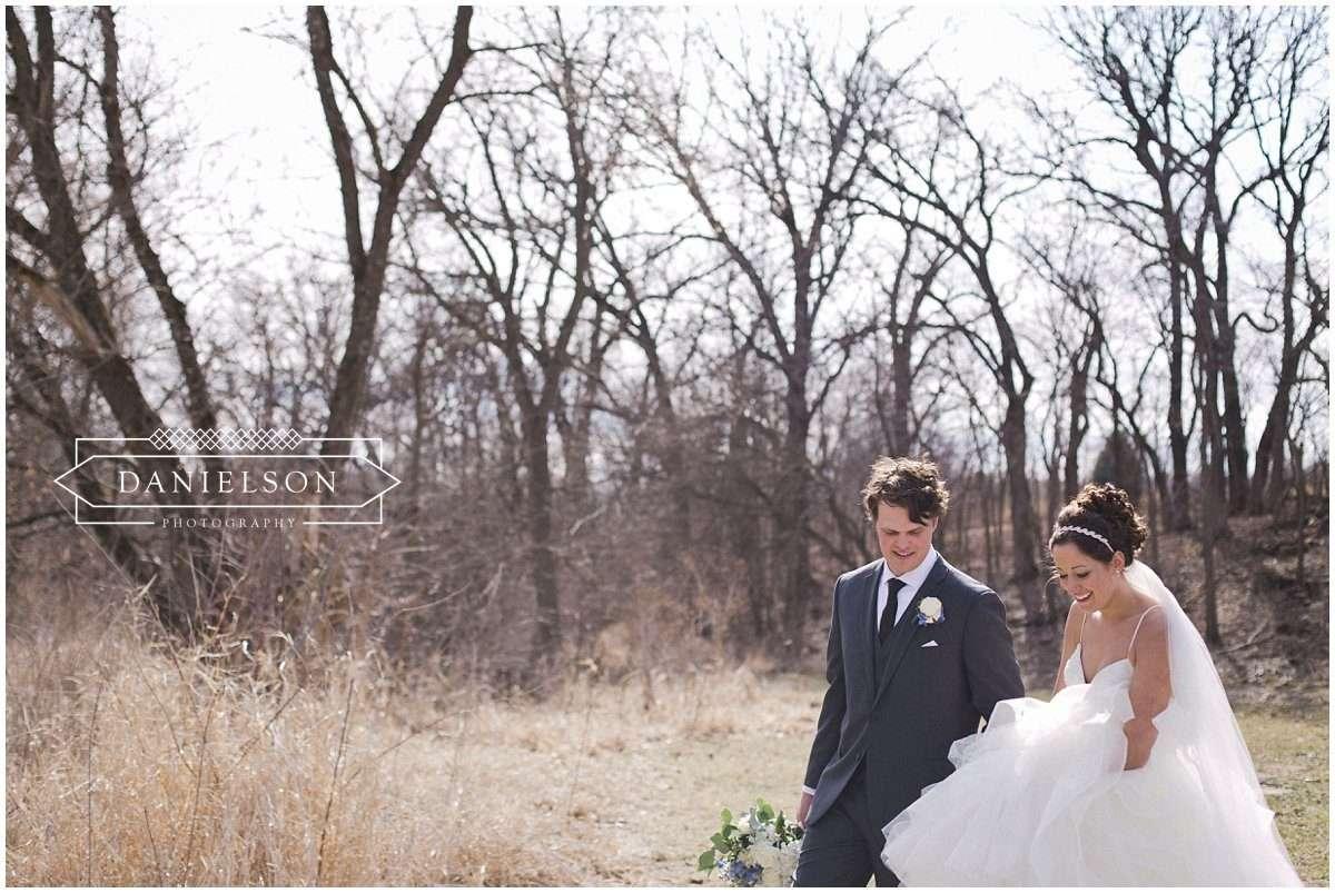 Rapid Creek Cidery weddings, Iowa CIty wedding photographer, Cedar Rapids wedding photographer, Rapid Creek Cidery, wedding ceremony, bride and groom in orchard