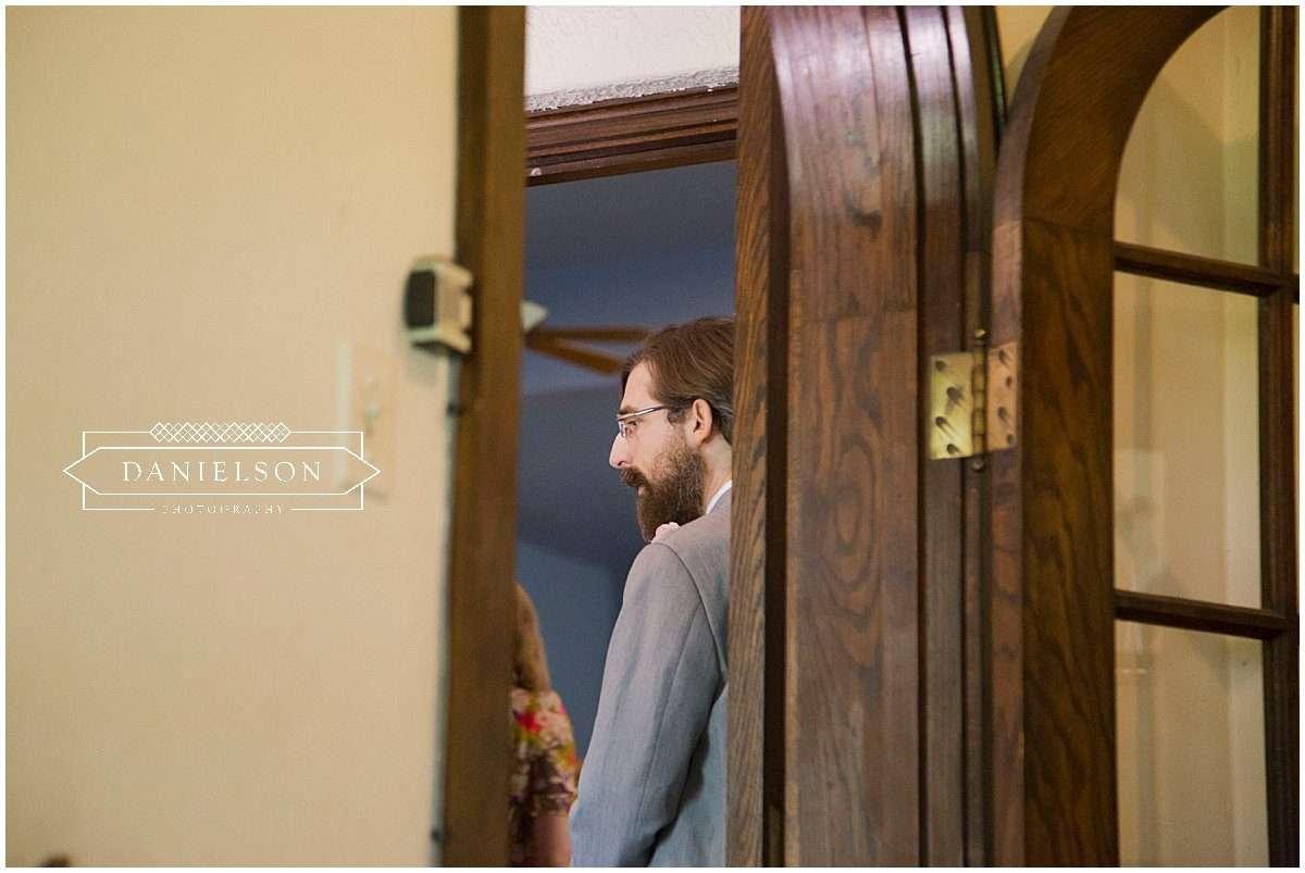 groom preparing to see bride before Orthodox wedding ceremony at St. Raphael Orthodox Church in Iowa City, Iowa CIty wedding vendors, Cedar Rapids wedding vendors