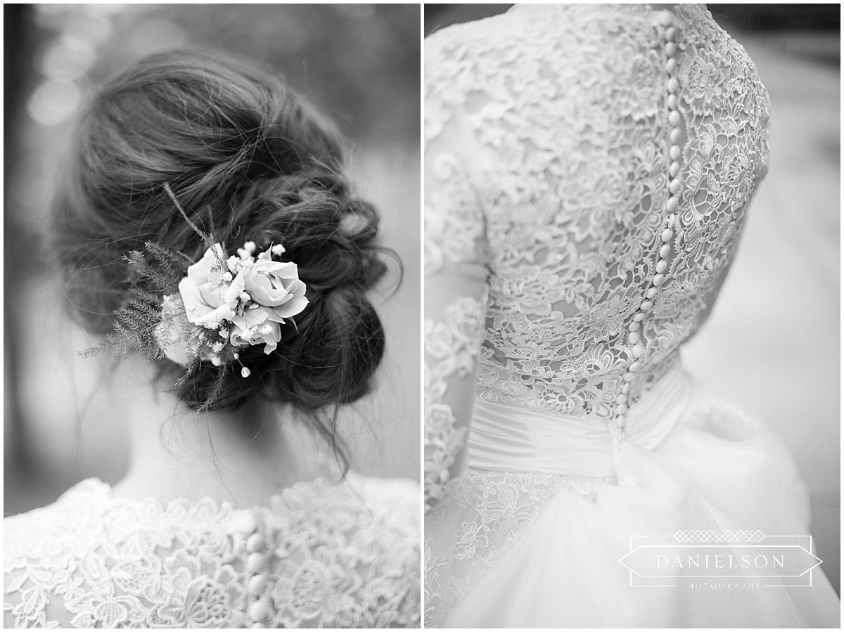 Detail shot of flowers in the bride's hair and the detailed lace of the back of her dress.
