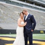 bride and groom on the field of Kinnick Stadium in Iowa City