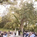 wedding ceremony under a giant oak tree on the grounds of Rapid Creek Cidery