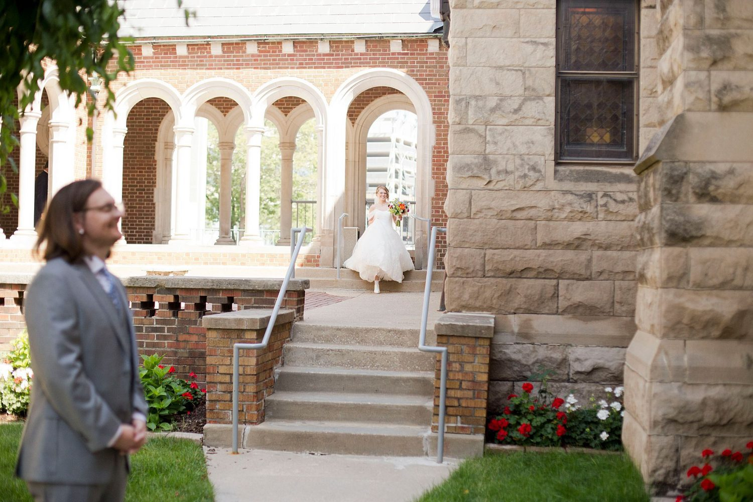 The groom waits in the courtyard of St Ambrose Cathedral in Des Moines as he waits to see his bride for the first time.