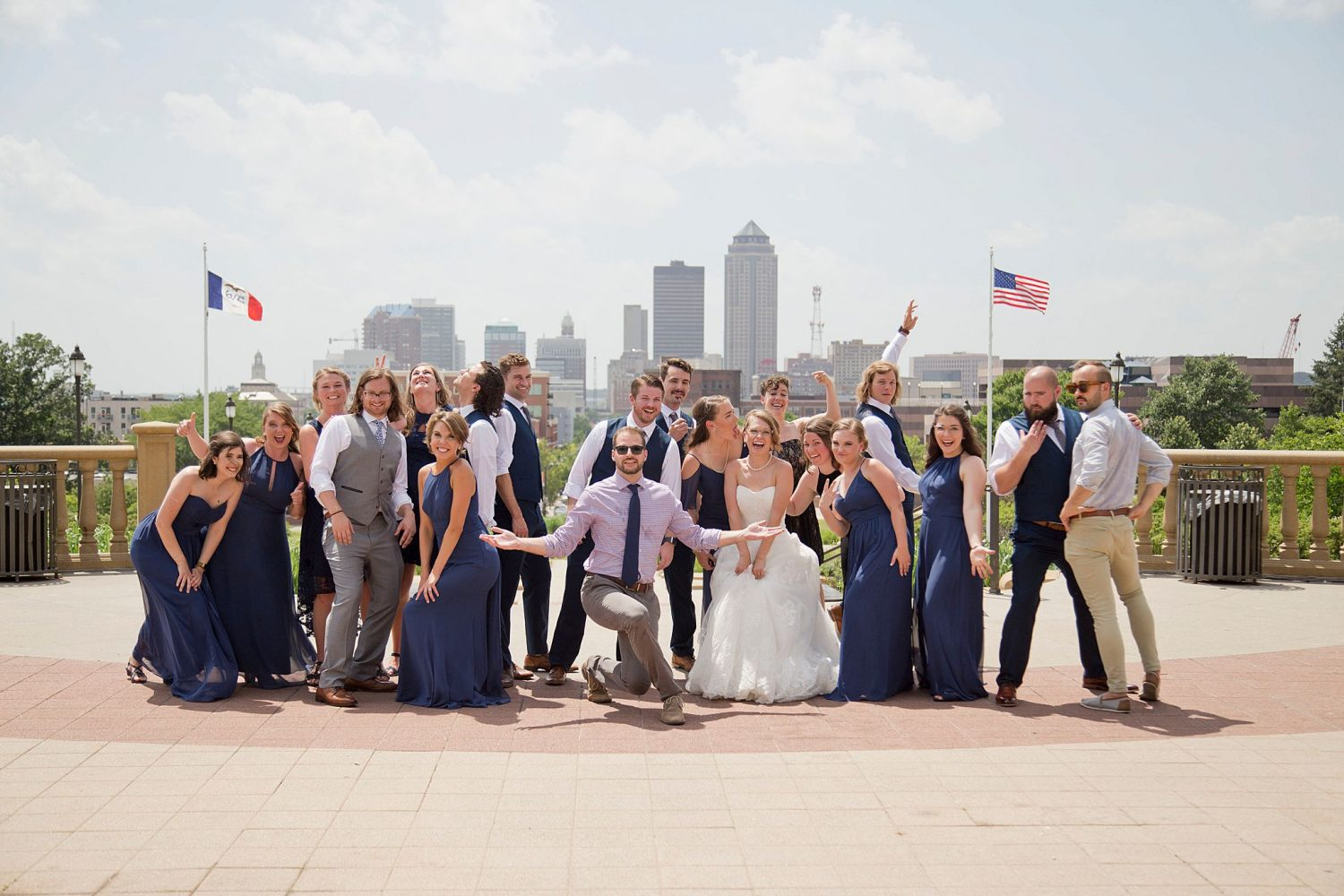 The bridal party pose for a goofy group picture with the Des Moines skyline behind them.