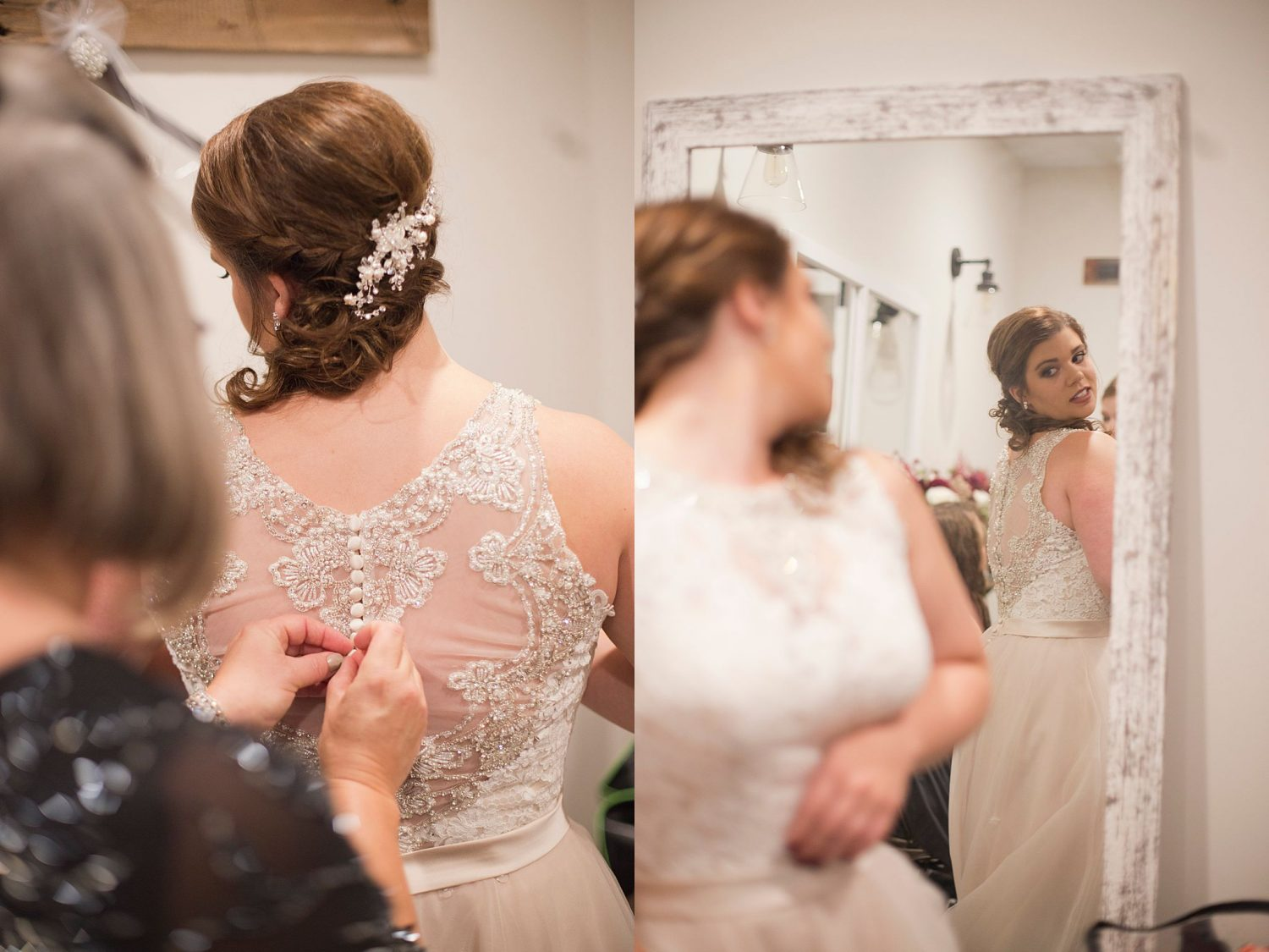 The bride peeks over her shoulder in the mirror to look at her dress with a smile.