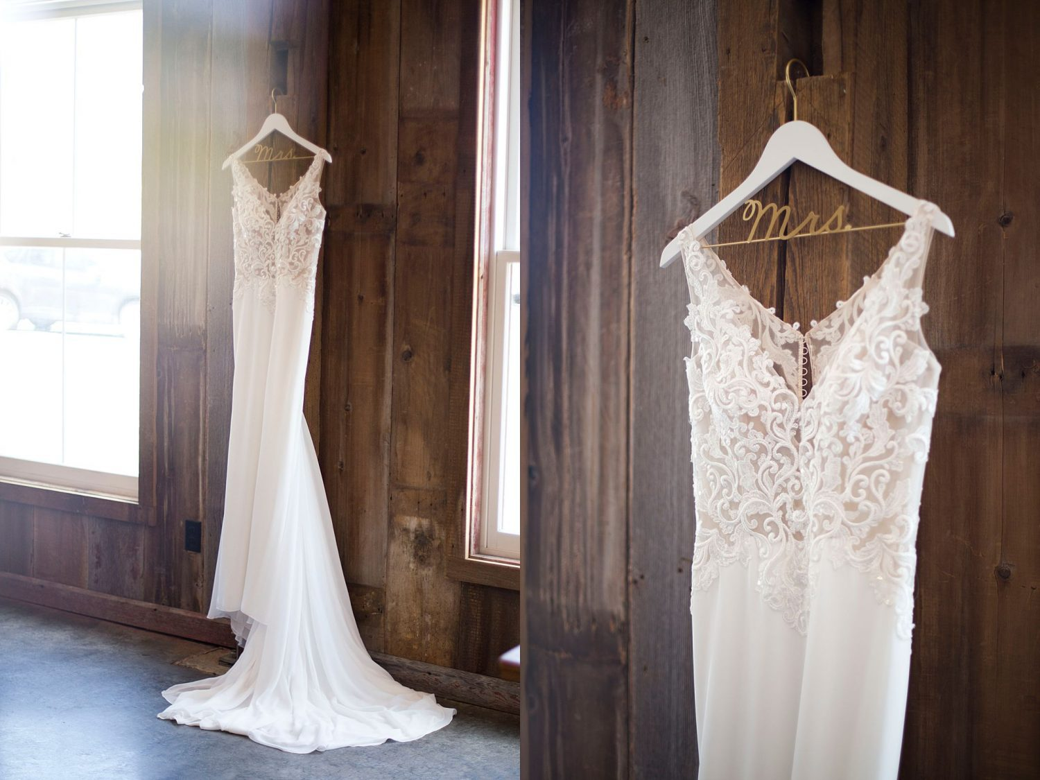 white wedding dress hangs on barnwood paneled wall