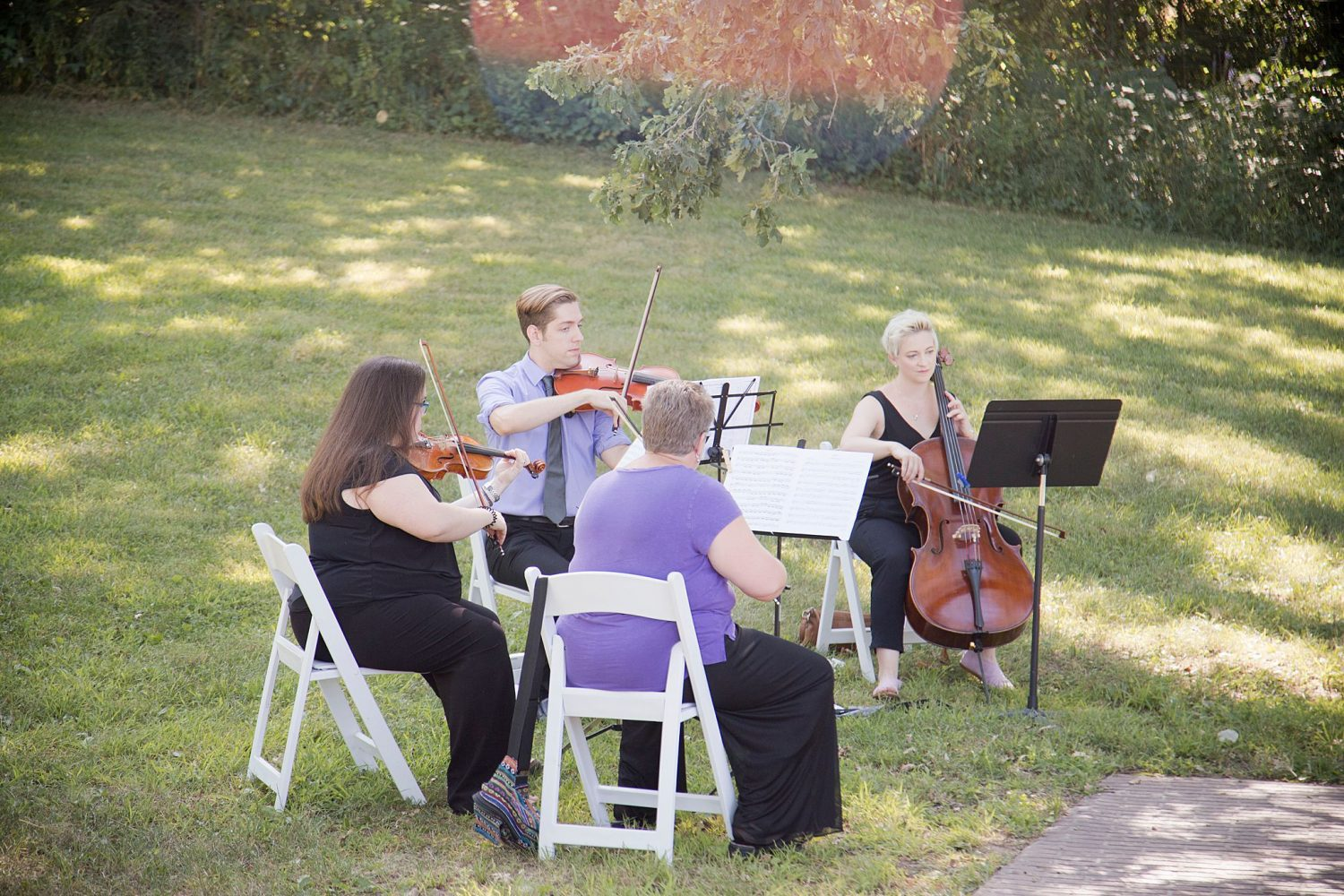A string quartet plays during ceremony at Rapid Creek Cidery.
