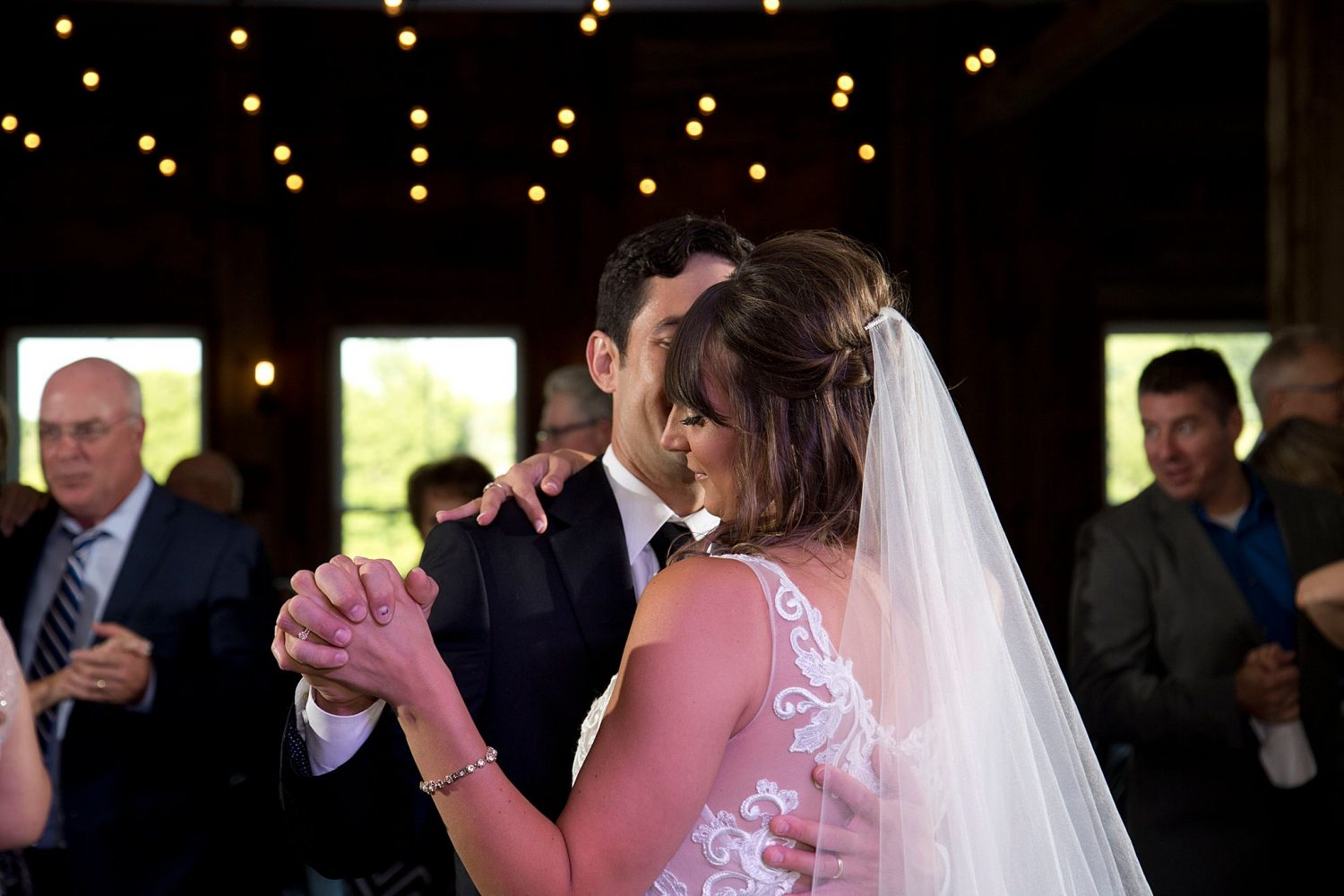 Bride and groom share their first dance with their guests at their wedding reception at Rapid Creek Cidery.