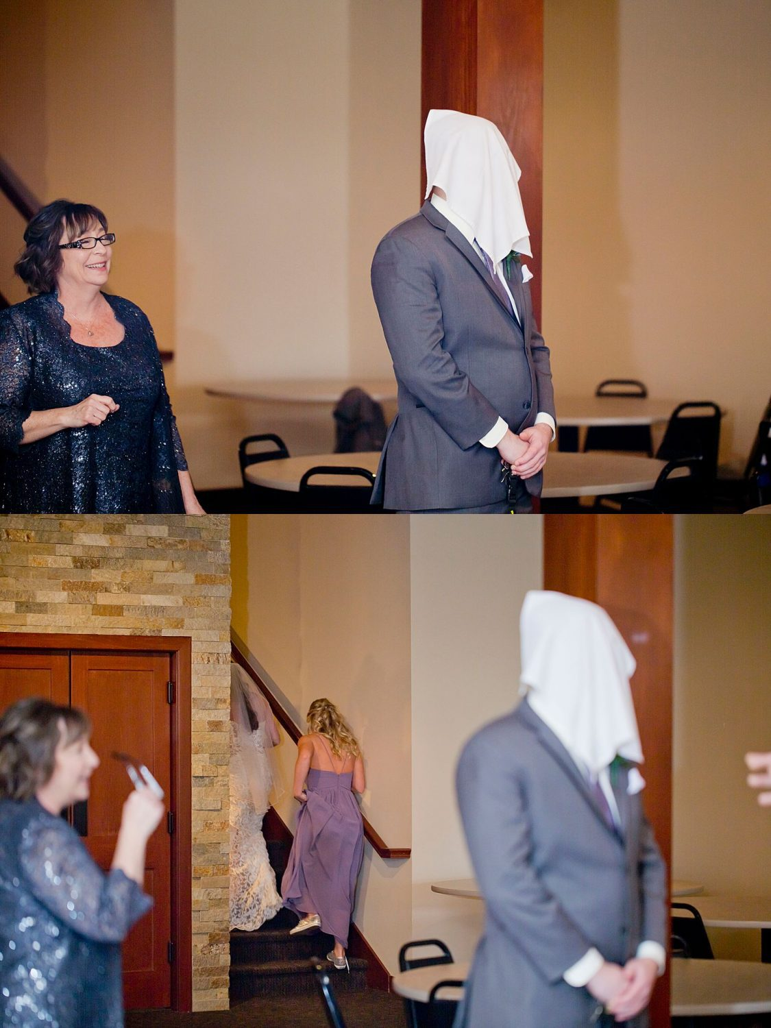 The groom stands with a towel over his head as his bride sneaks past to hide upstairs before the ceremony.
