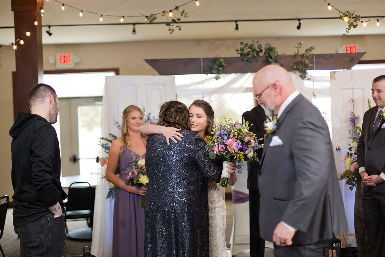 Bride hugs her mom as she is given away to her groom.